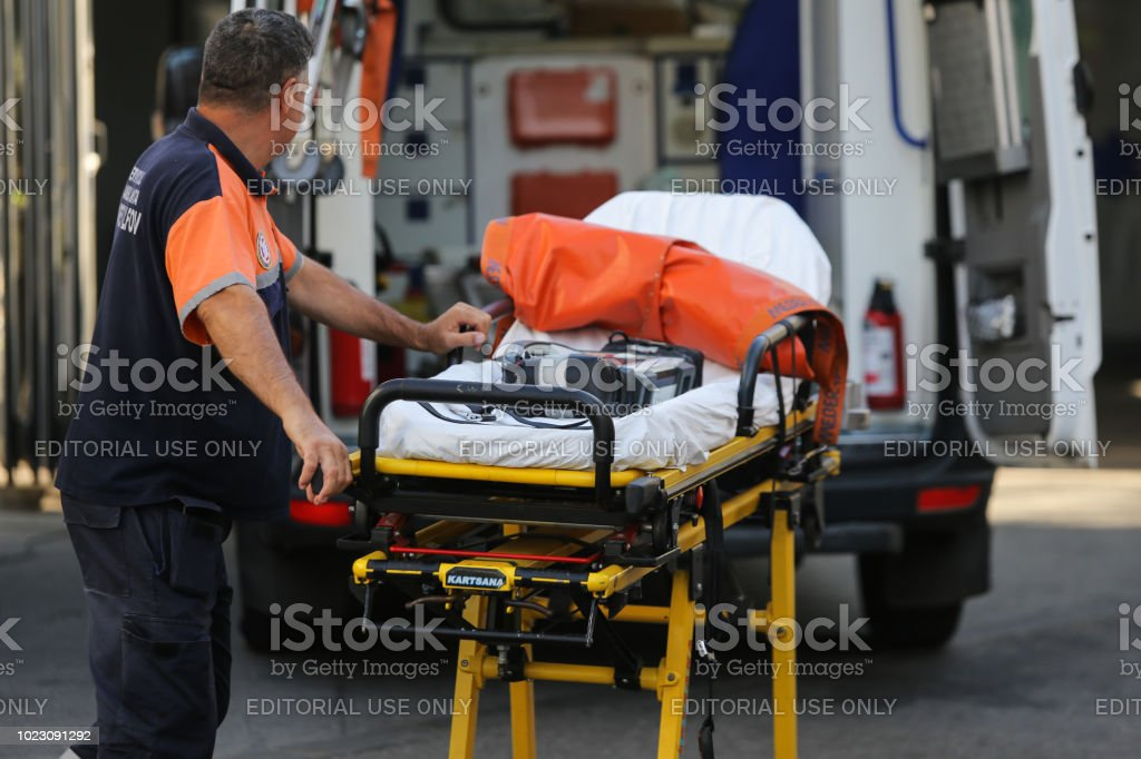 Paramedic from an ambulance push an empty stretcher stock photo