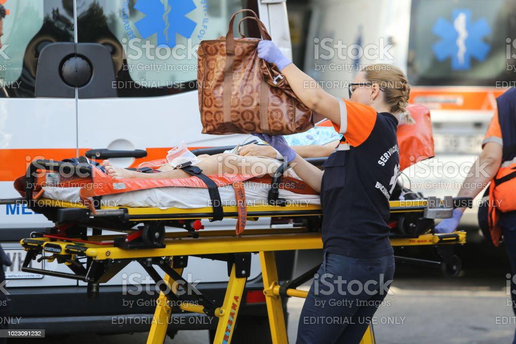 Paramedic from an ambulance transport a patient on a stretcher stock photo