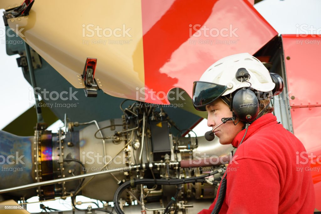 Paramedic Helicopter Crew Checks the Aircraft's Engine stock photo
