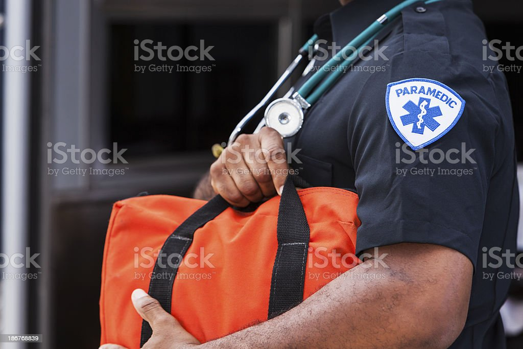 Paramedic holding medical bag stock photo