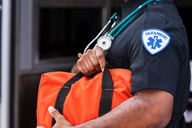 Paramedic holding medical bag stock photo