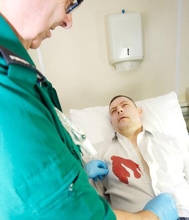 Nurse Using Medical Facility Checking Pulse And Blood
