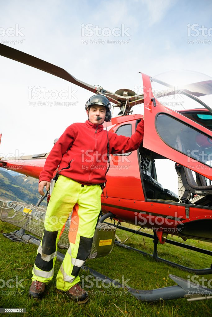 Paramedic Poses with Mountain Rescue Helicopter stock photo