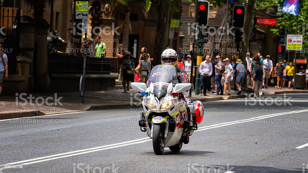 Paramedic rides a motorcycle ambulance in Sydney stock photo