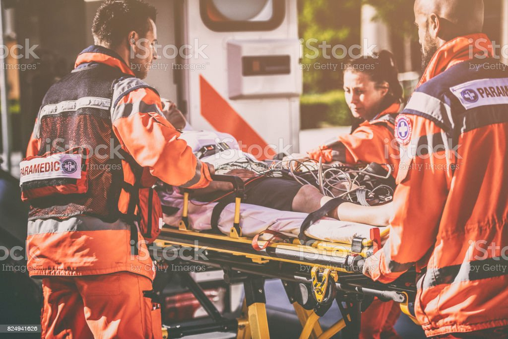 Paramedic team helping injured person stock photo