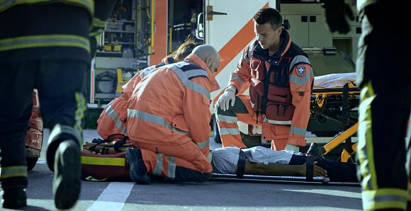 istock Paramedic team immobilizing male injured in car crash 1045845496