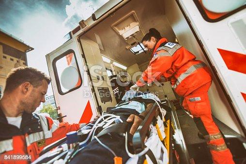 istock Paramedic team pushing stretcher 841899584