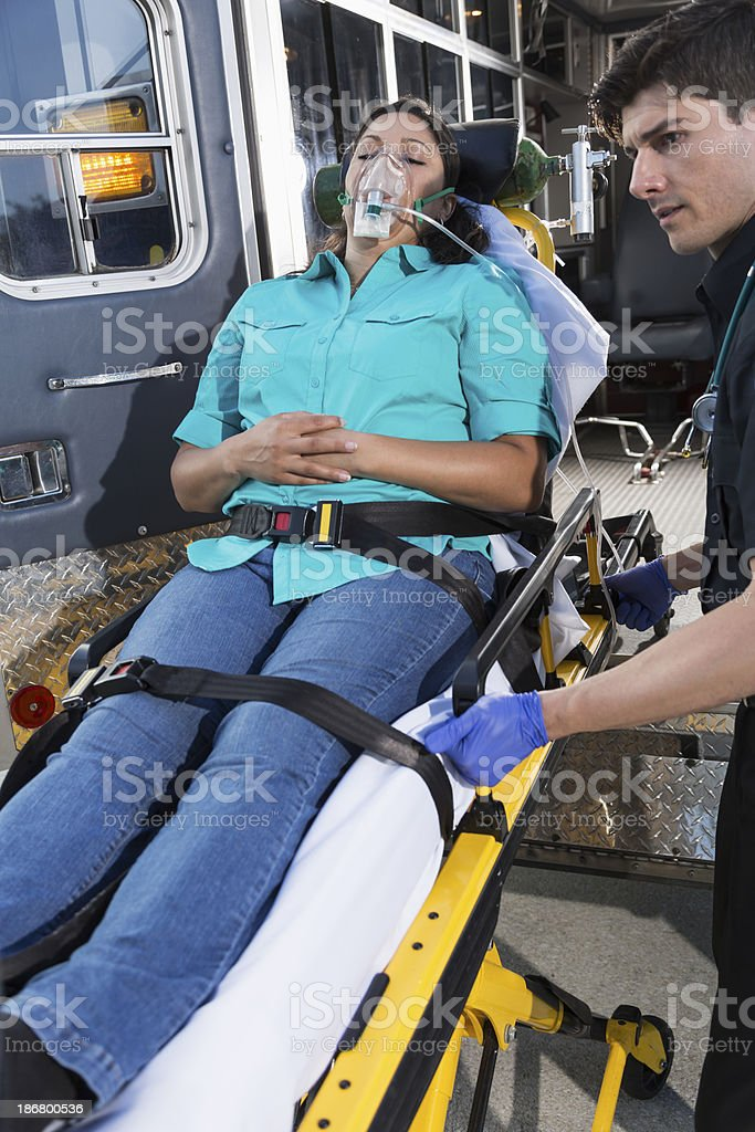 Paramedic with patient on stretcher royalty-free stock photo