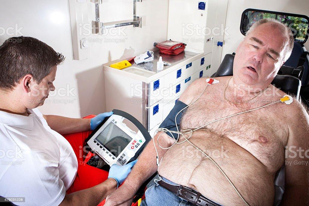 Paramedics ambulance emergency first aid ecg stock photo