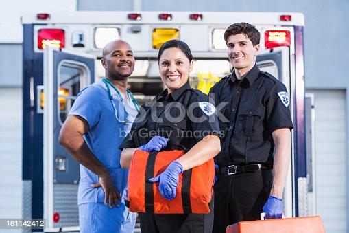 istock Paramedics and doctor outside ambulance 181142412