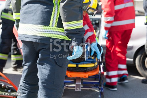 istock Paramedics and firefighters in a rescue operation after road traffic accident 1127089044
