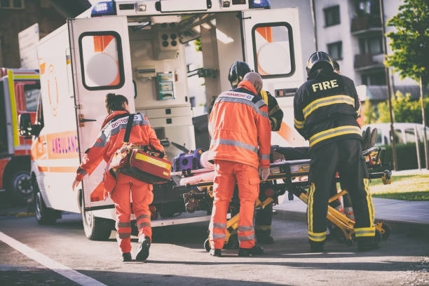 Paramedics and firefighters stock photo