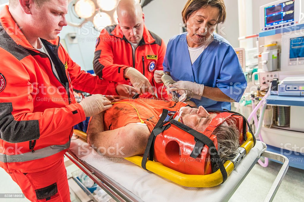 Paramedics and nurse in emergency room stock photo