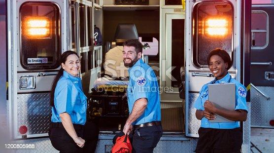 istock Paramedics at the rear doors of an ambulance 1200805988