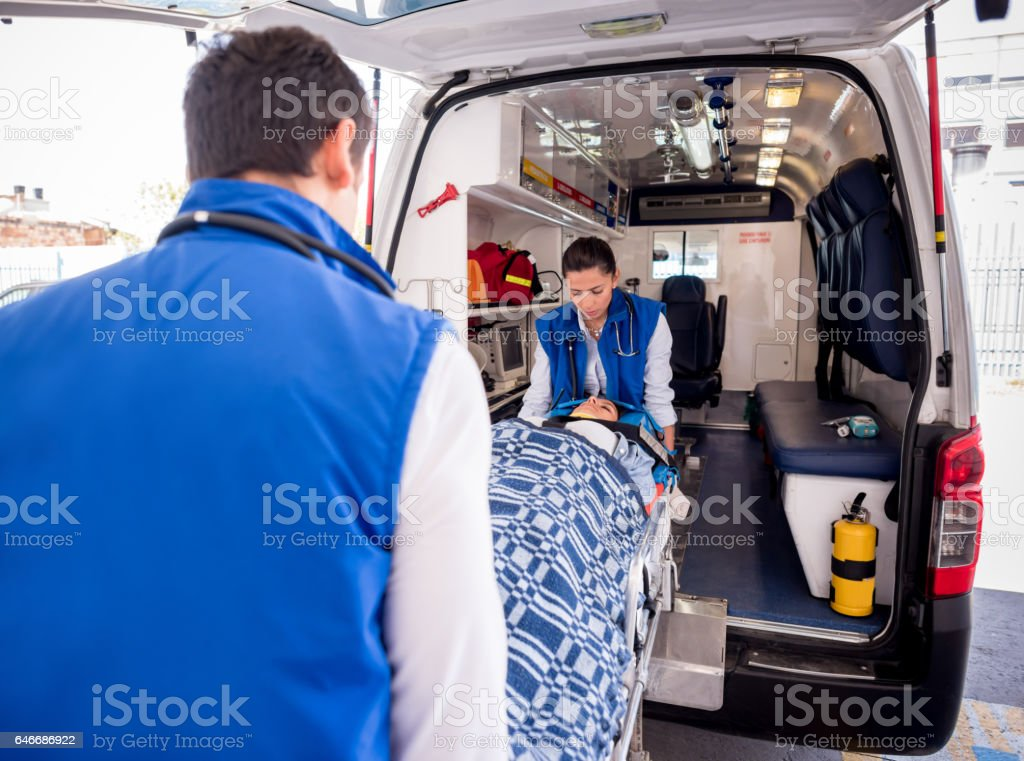 Paramedics attending an emergency call stock photo