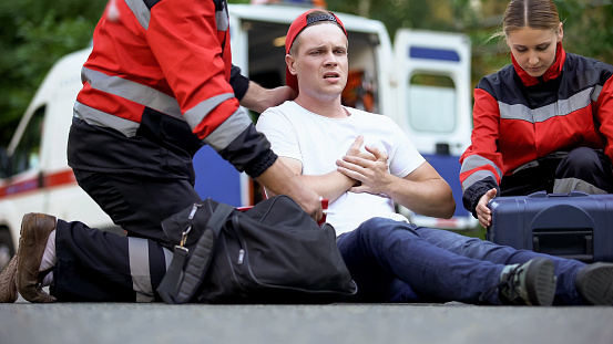 istock Paramedics caring for man suffering from chest pain, qualified medical care 1131889412