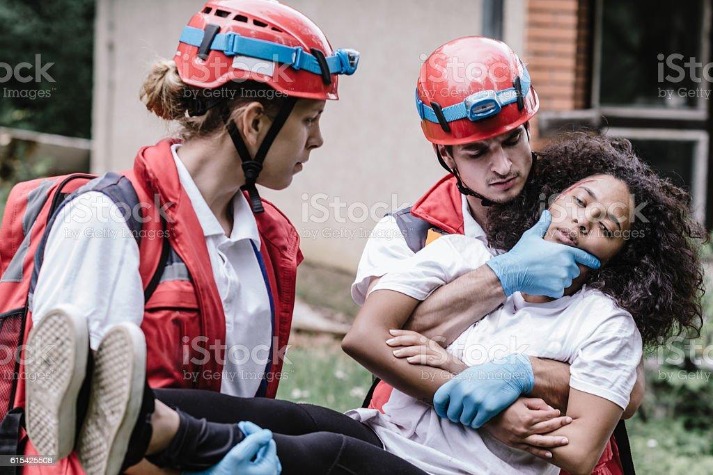 Paramedics evacuating victim after natural disater stock photo