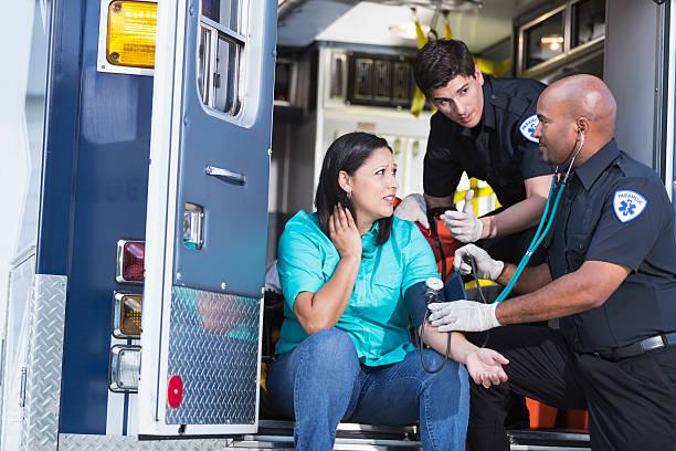 Paramedics helping a patient stock photo