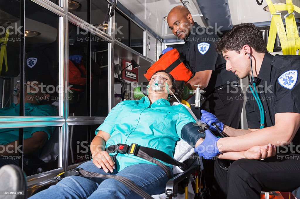 Paramedics helping a patient stock photo