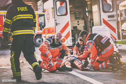 istock Paramedics helping injured cyclist 825260440