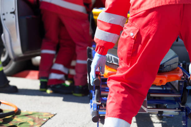 Paramedics in a rescue operation after road traffic accident Paramedics in a rescue operation after a car crash ambulance staff stock pictures, royalty-free photos & images