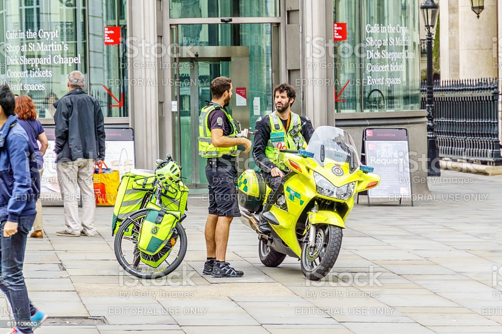 Paramedics on motorcycle and bicycle emergency response vehicles stock photo