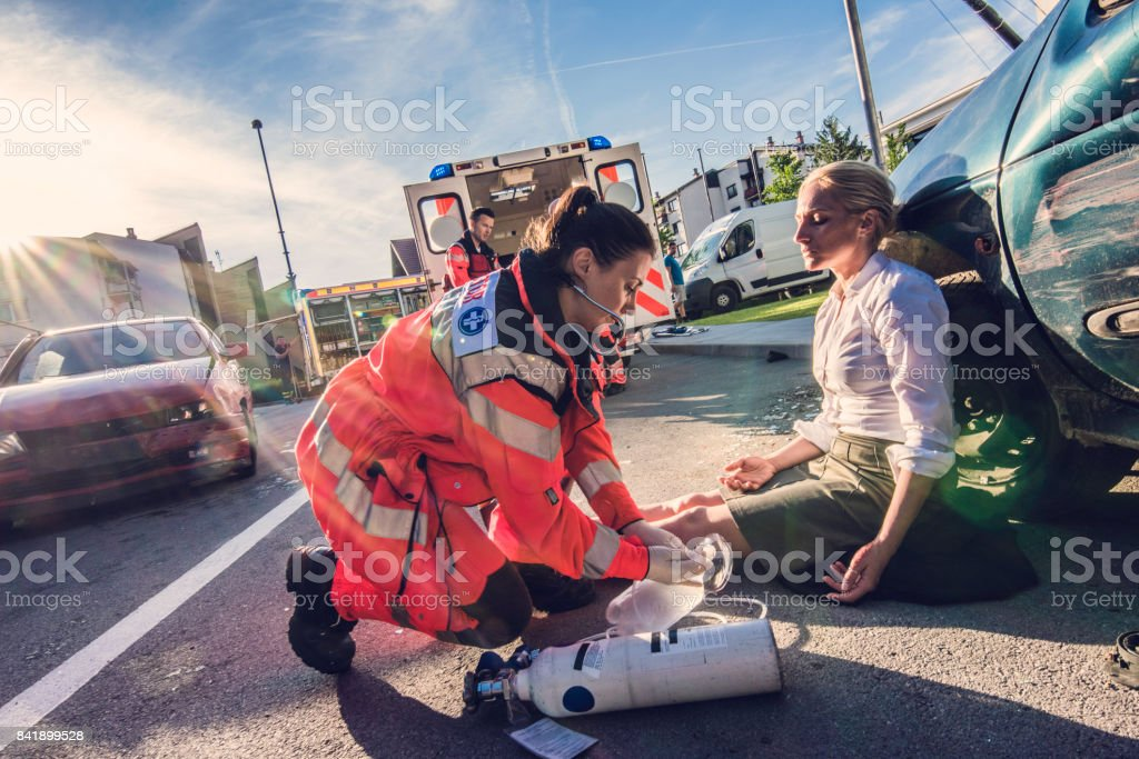 Paramedics providing first aid stock photo