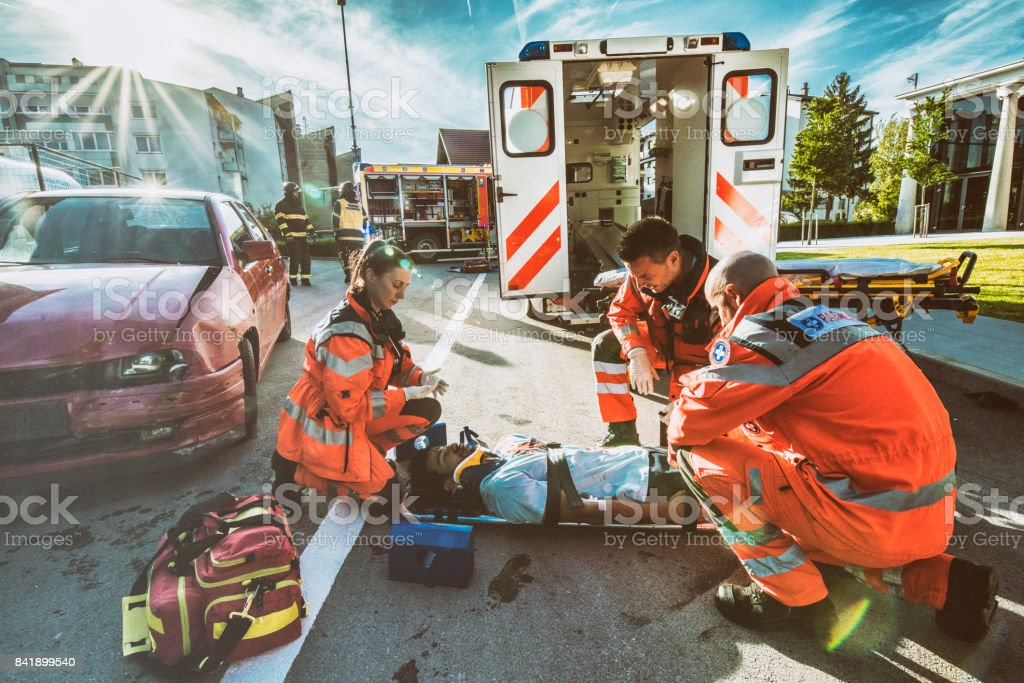 Paramedics providing first aid stock photo