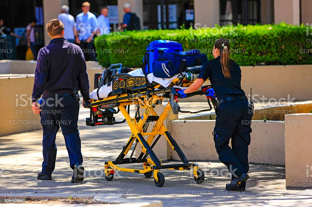 Paramedics pushing a gurney in Santa Barbara stock photo
