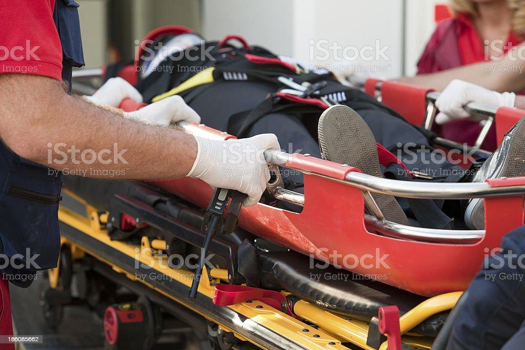 Paramedics rushing patient into an ambulance stock photo