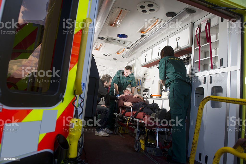 Paramedics see to patient stock photo