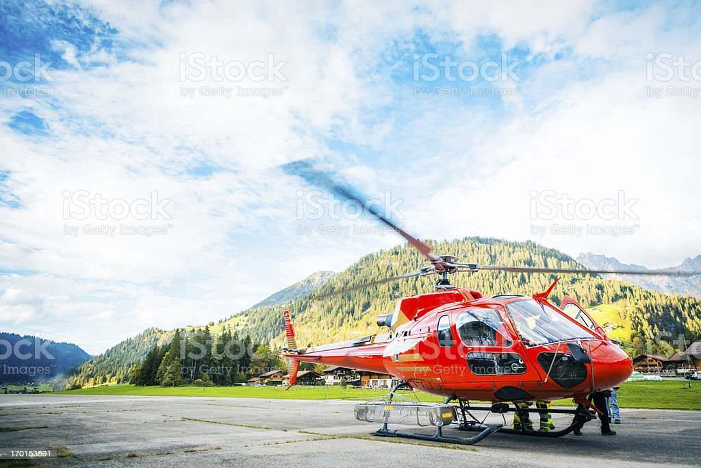 paramedics standing by their helicopter stock photo