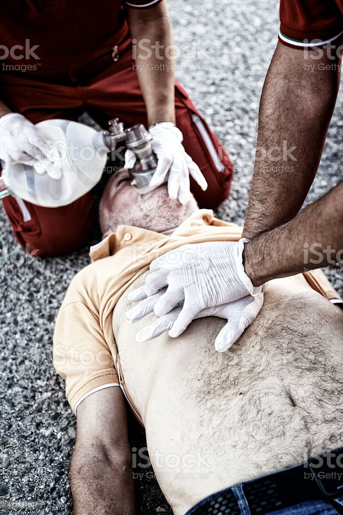 Paramedics succor a man with heart attack royalty-free stock photo