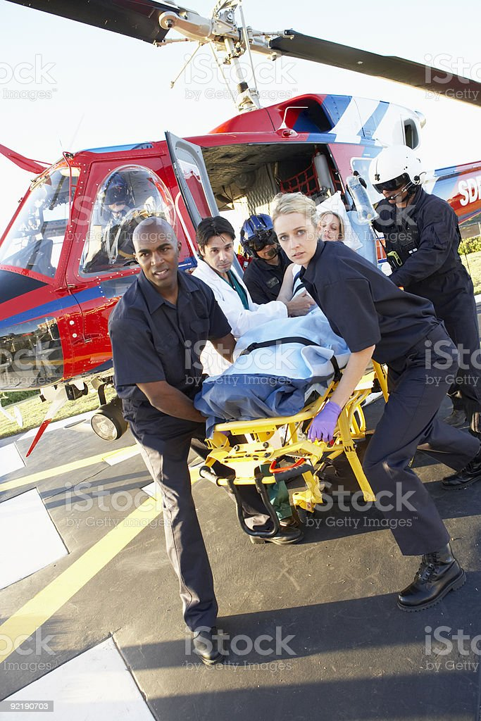 Paramedics unloading patient from Medevac stock photo