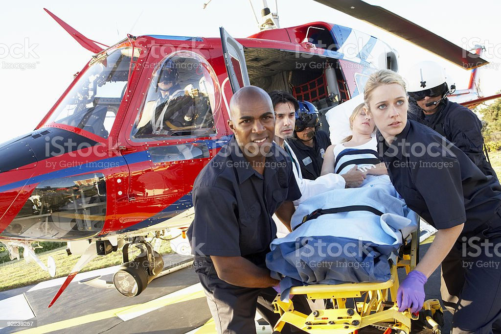 Paramedics unloading patient from Medevac royalty-free stock photo