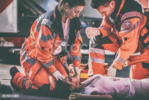 istock Paramedics with car accident victim 824941484