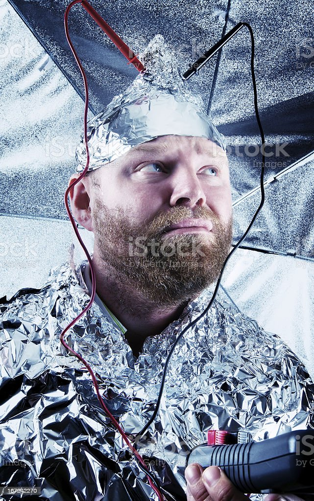 Paranoid Dude with a Tin Foil Hat stock photo