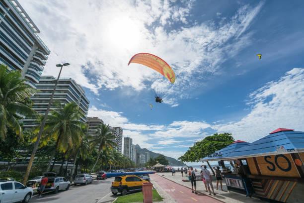 Paraplan flying above Sao Conrado Beach stock photo