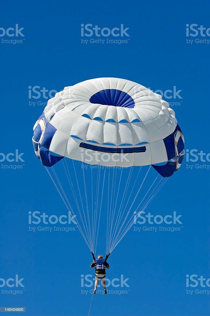 Parasailer Against Blue Sky Vertical royalty-free stock photo