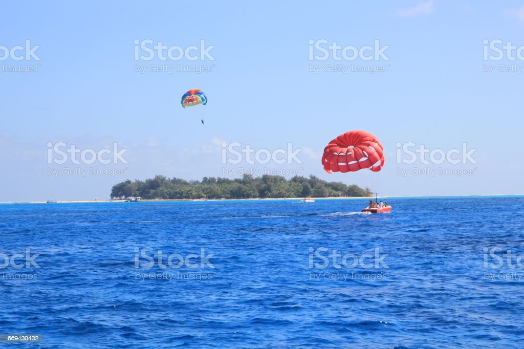 Parasailing at Managaha Island, Saipan, Northern Mariana Islands stock photo