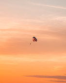 A man take a photo while parasailing