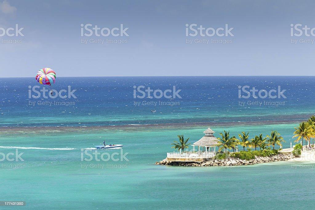 Parasailing in Jamaica over gazebo stock photo