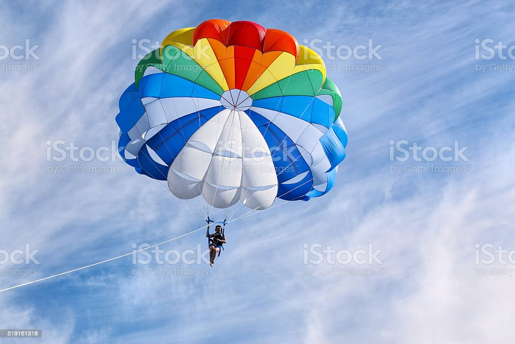 Parasailing in sunny day stock photo