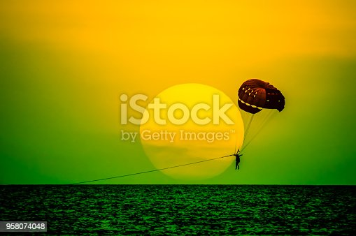parasailing parachute on sunset at Pattaya beach Thailand