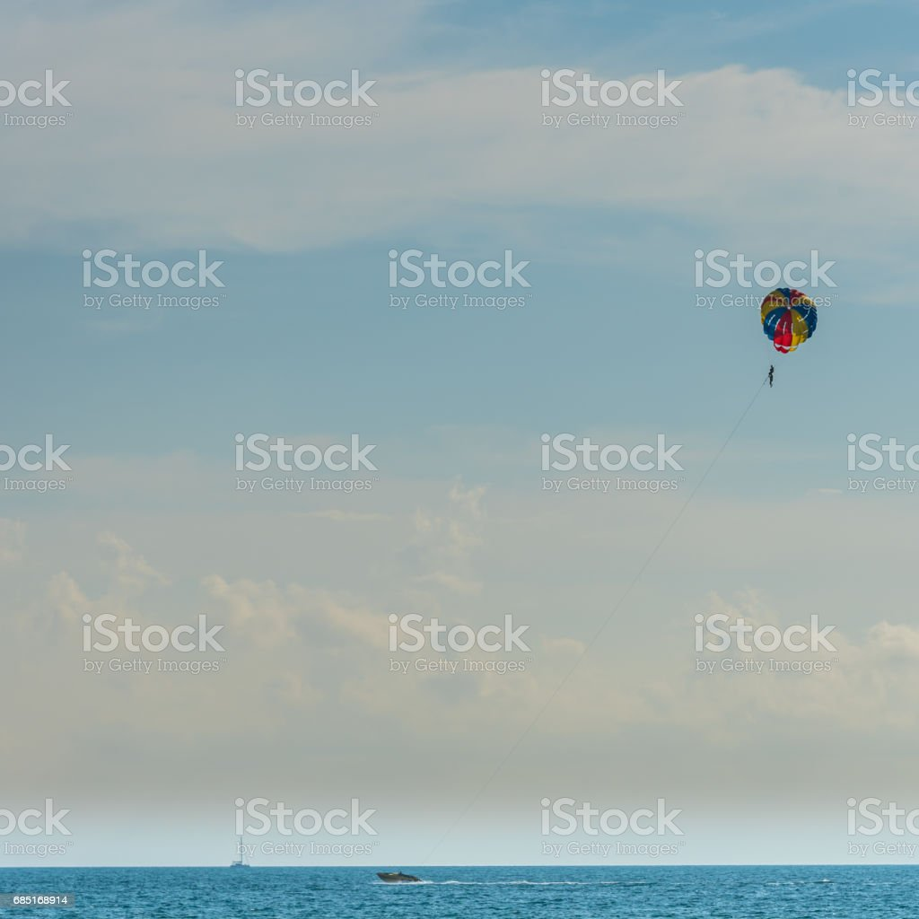 parasailing with speed boat royalty-free stock photo
