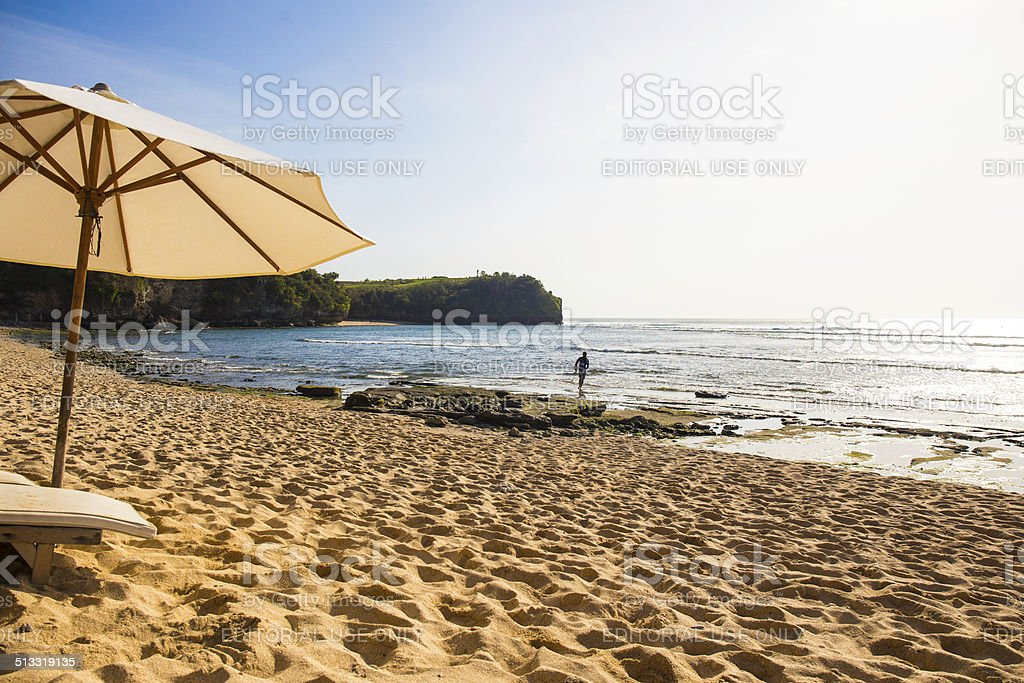 Parasol and chaise longue on the beach. stock photo