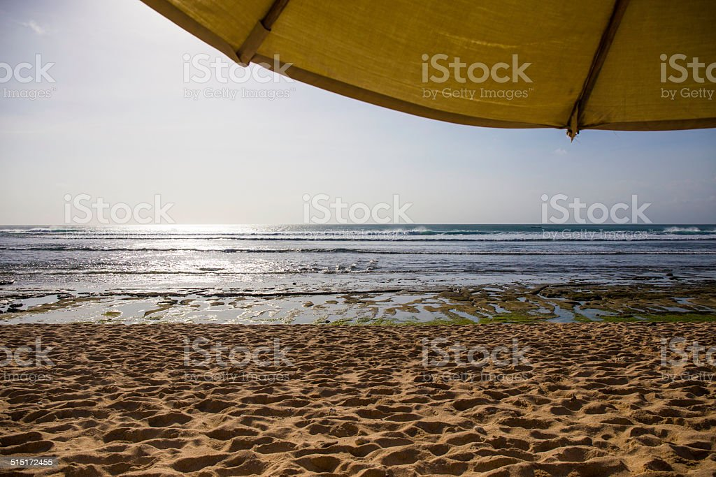 Parasol and ocean in background stock photo