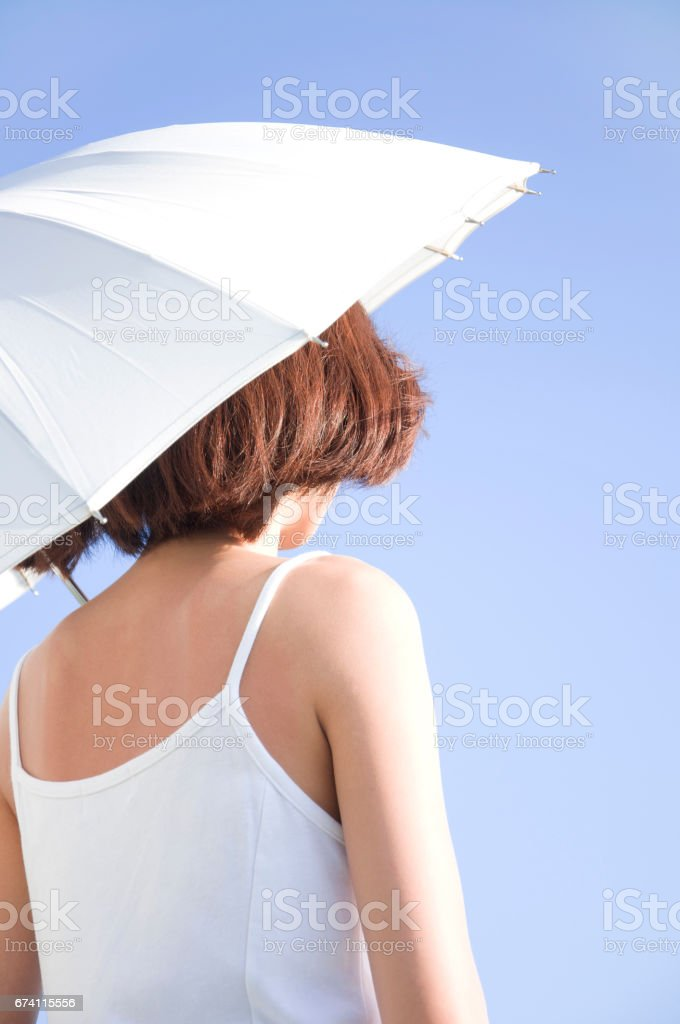 Parasol woman from behind royalty-free stock photo