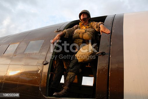 Stock photograph of US Paratroopers standing in the door of C-47 aircraft.