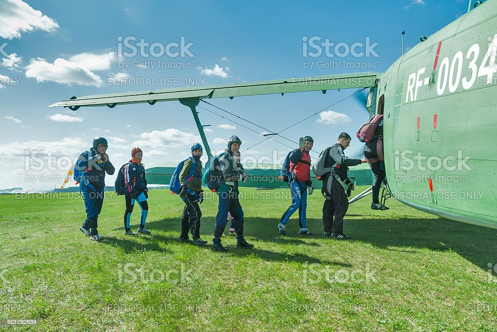 Paratroopers enter into AH-2 plane stock photo